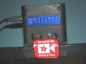 "Arduino-based device with LCD menu sits atop my TV probably displaying an Adafruit ""As Seen on Show & Tell"" sticker."